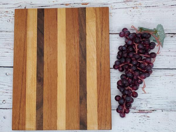 Handmade maple, walnut, and spanish cedar cheeseboard