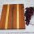 Handmade maple, walnut, cherry, and spanish cedar cheeseboard alternate view