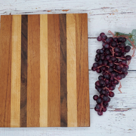 Handmade maple, walnut, and spanish cedar cheeseboard