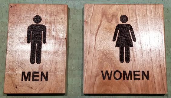 Custom restroom signs wood burned on Cherry