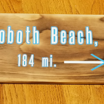 Rehoboth Beach, DE mileage sign
